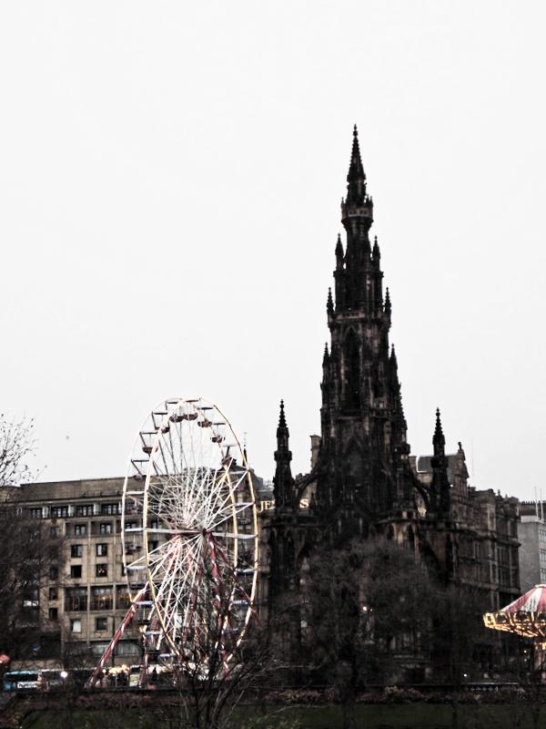 Edinburgh's ferris wheel looking quite eerie next to The Scott Monument