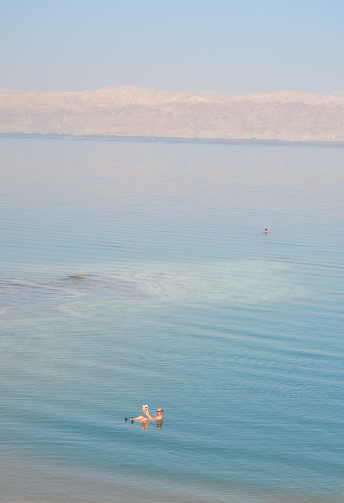 The Dead Sea, Jordan. Reading a newspaper.